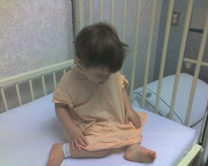 Checking out her hospital gown