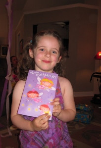 Showing off her sparkly, light-up card